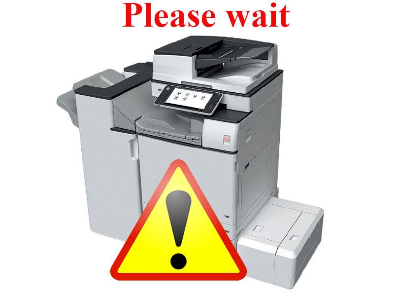 Máy photocopy Ricoh báo lỗi please wait